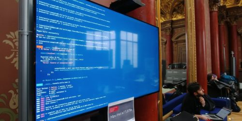 Some code displayed on a giant screen of the Paris office during the MDN Paris Event