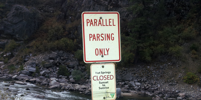 "a road sign that says ""parallel parsing only"""